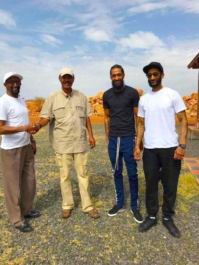 Nipsey Hussle and his family with Eritrean president Isaias Afwerki when they visited last year . Photo via  @hadnetkeleta /Twitter.