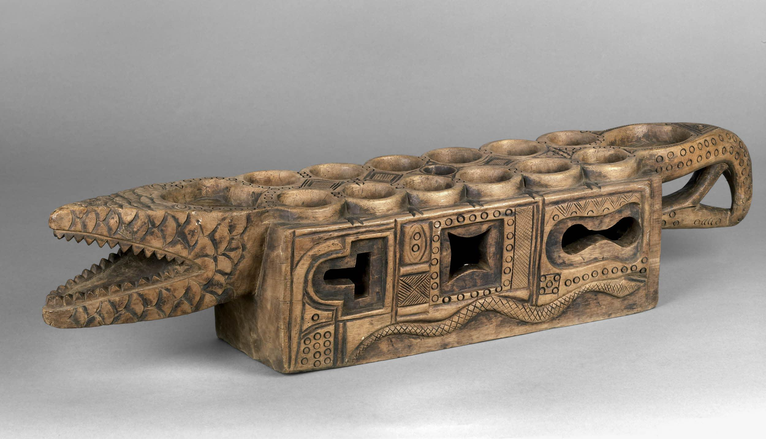 An Ekoi (Nigerian) board made out of wood and tin. Photo by: British Museum.
