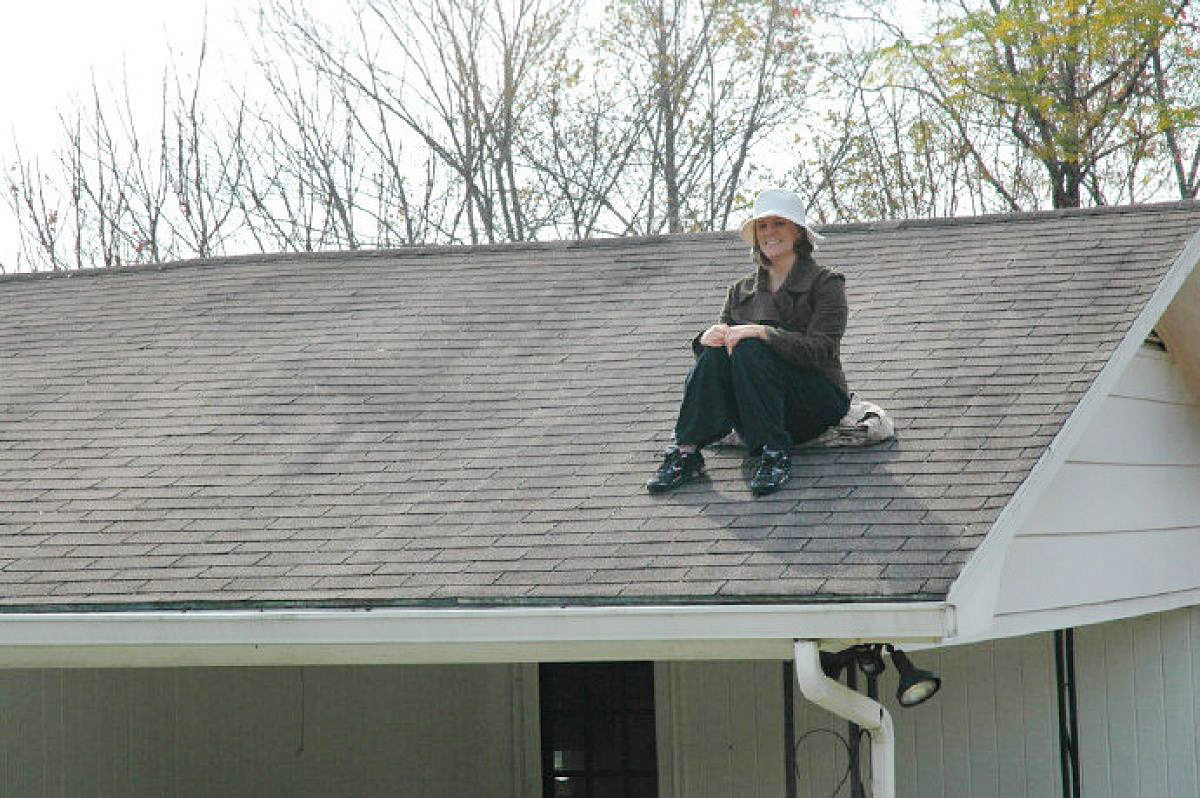 Rachel Held Evans, for being a contentious woman, sits on the roof of her house during the year the Christian feminist tried to live according to the rules of the Bible