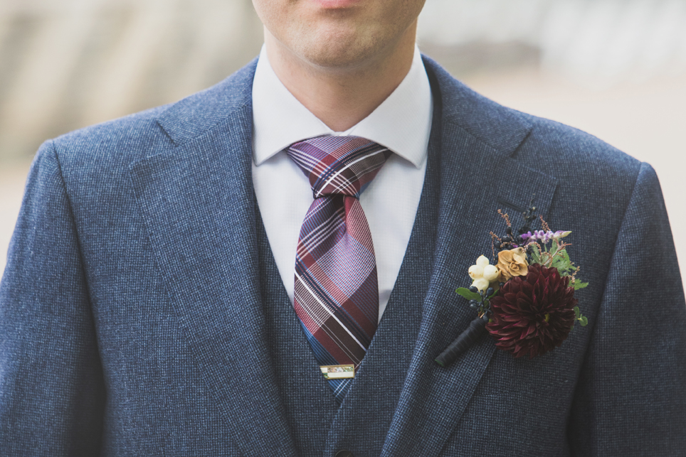 Floral wedding Boutonnière for clients at the Race Street Pier in Philadelphia PA. Wedding Photography by Smile Peace Love Creative.