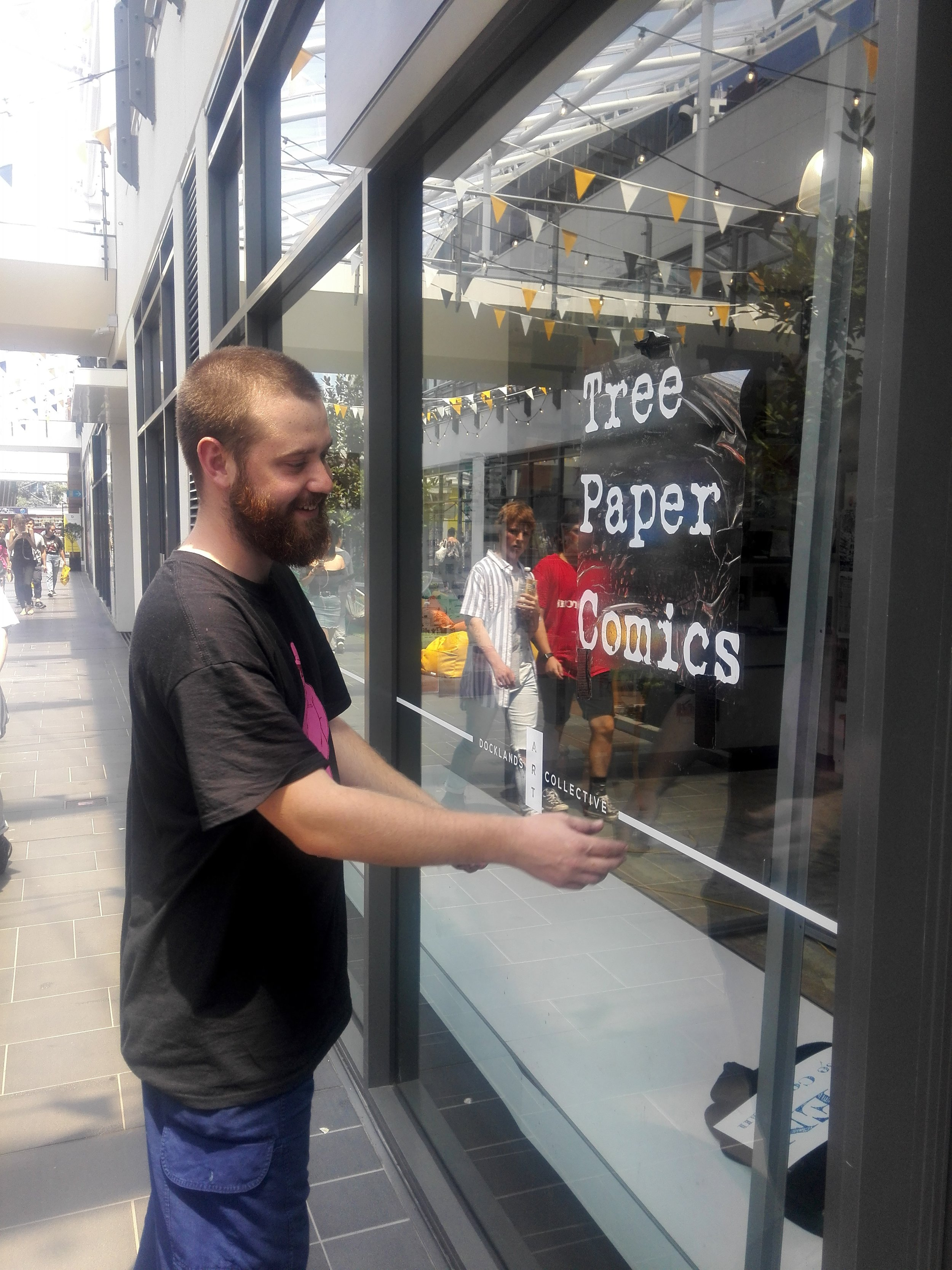 Ruskidd putting the finishing touches on the signage.