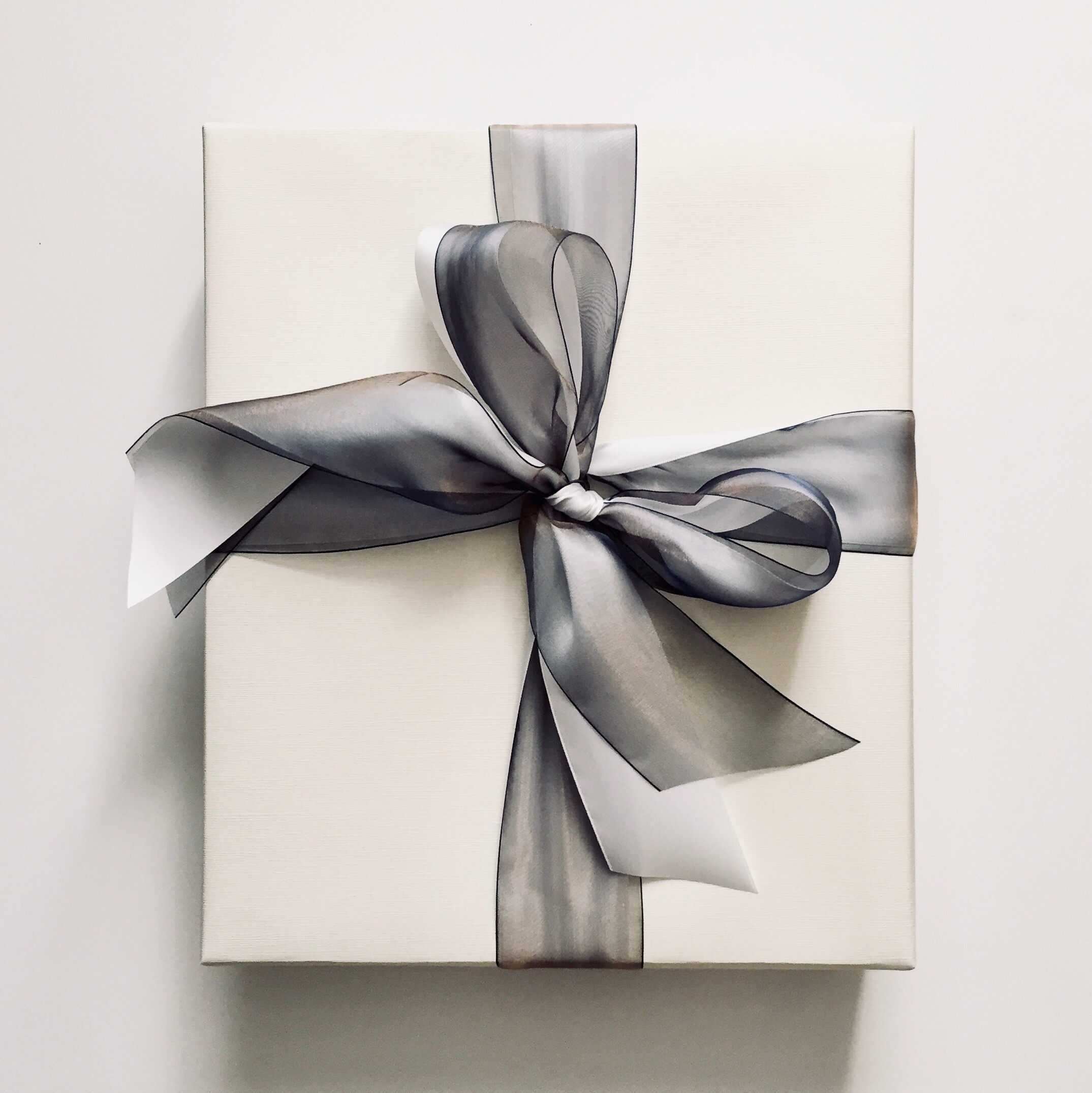 How long does it take to get a present wrapped? - My typical turnaround time (with some exceptions) is a minimum of four business days for up to 20 items; for every additional 20 items, add one day. For example, 50 gifts would take a minimum of six business days. More elaborate custom designs will take longer.Turnaround time is calculated from the time I receive items for wrapping.Depending on availability, I may be able to complete projects more quickly; on rare occasions, I can provide same-day service. (Please contact me to check.) Rush fees will apply.Please note that although I can work quickly, the more time I have to work on your project, the more design options and materials choices there will be — some options just aren't available when there are only a few days to complete a project. Timing may also affect cost, as more economical wholesale materials often require a few weeks for delivery.
