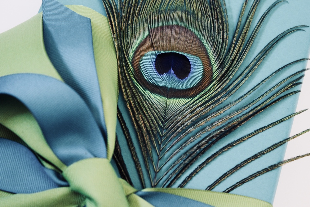 Peacock-motif client gifts wrapped by corinna vanGwerwen