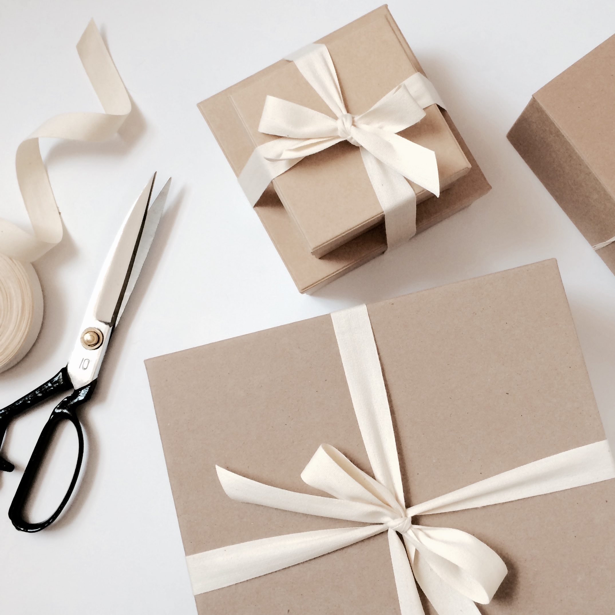 4. Wrapping begins - Once you've approved the design, my team and I get busy wrapping! Gifts will be carefully packaged to impeccable perfection to create that Wow experience, from the inside out. Along the way, we'll keep you up to date on the project's progress.