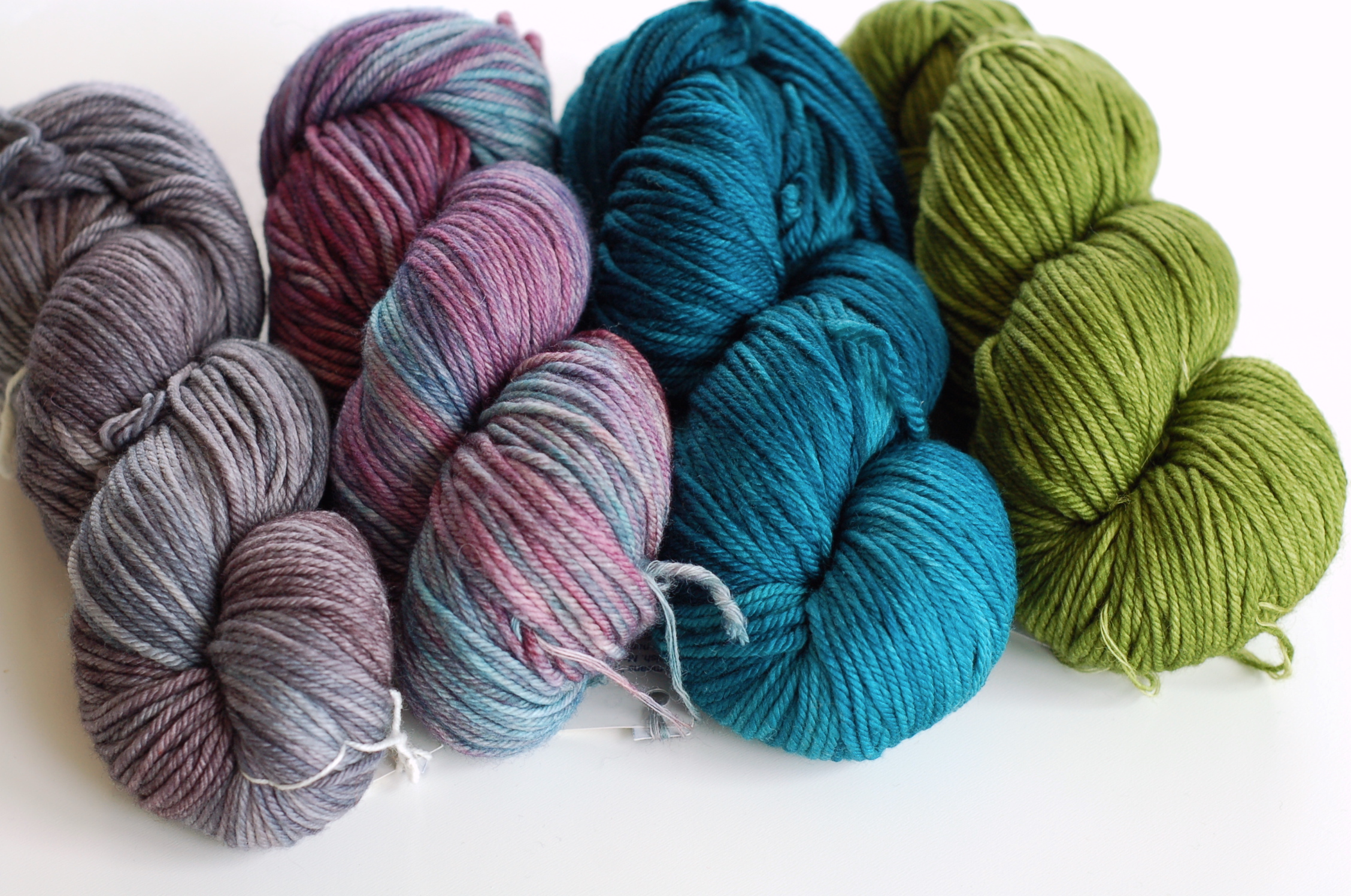 Malabrigo Rios in colorways Plomo, Lotus, Teal Feather and Lettuce