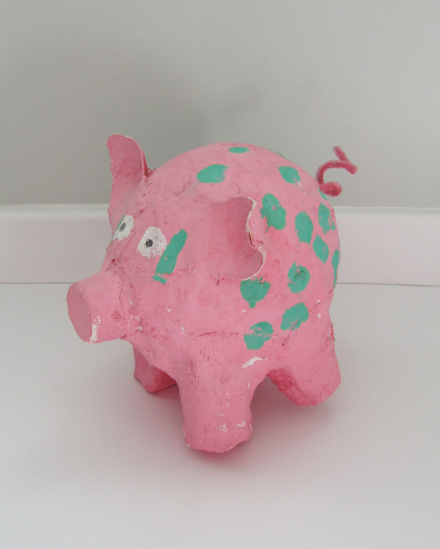 Pink paper mache pig made for her father in 1st grade. This has always been Dad's most prized piece of art.