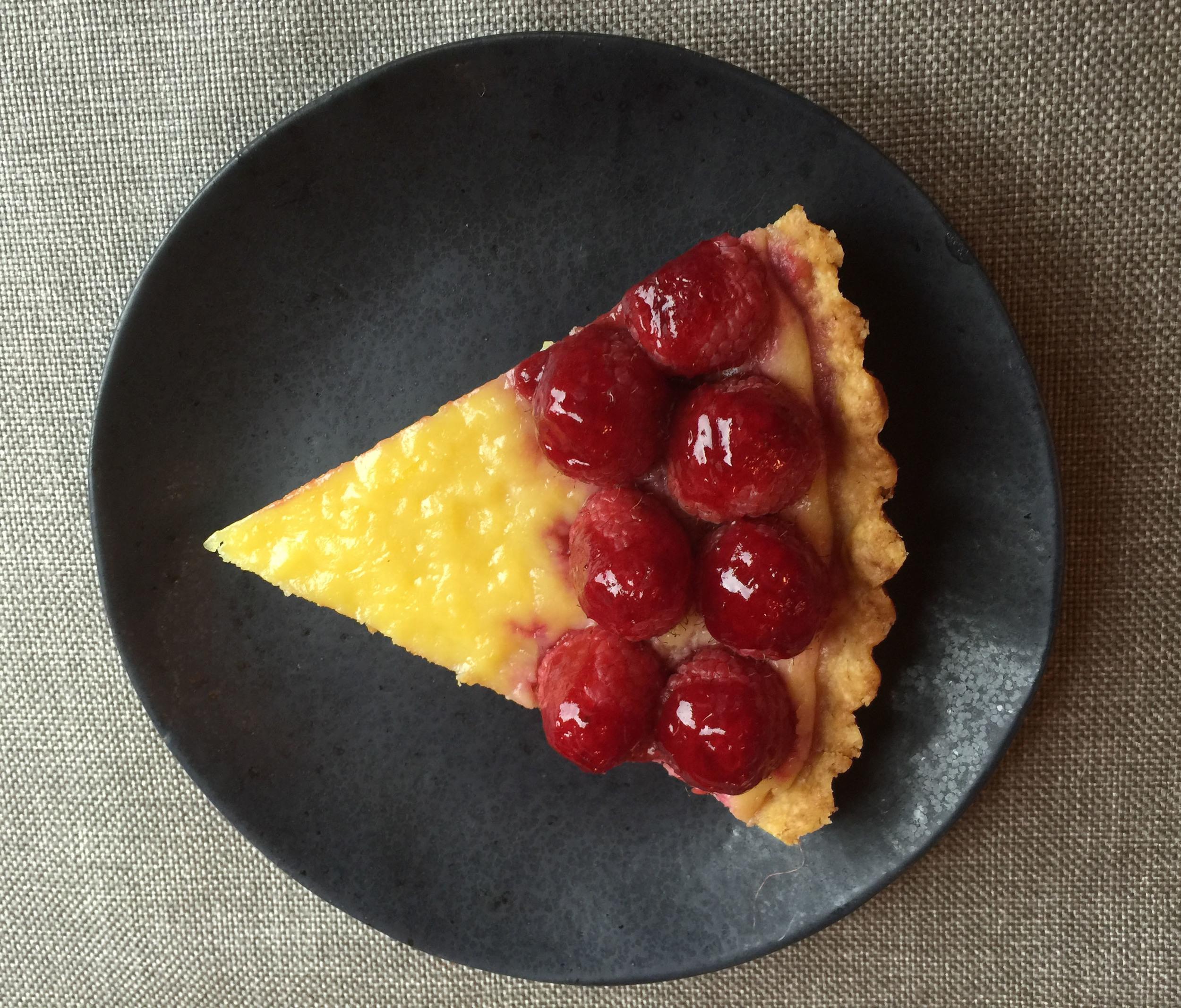 A slice of lemon-raspberry tart