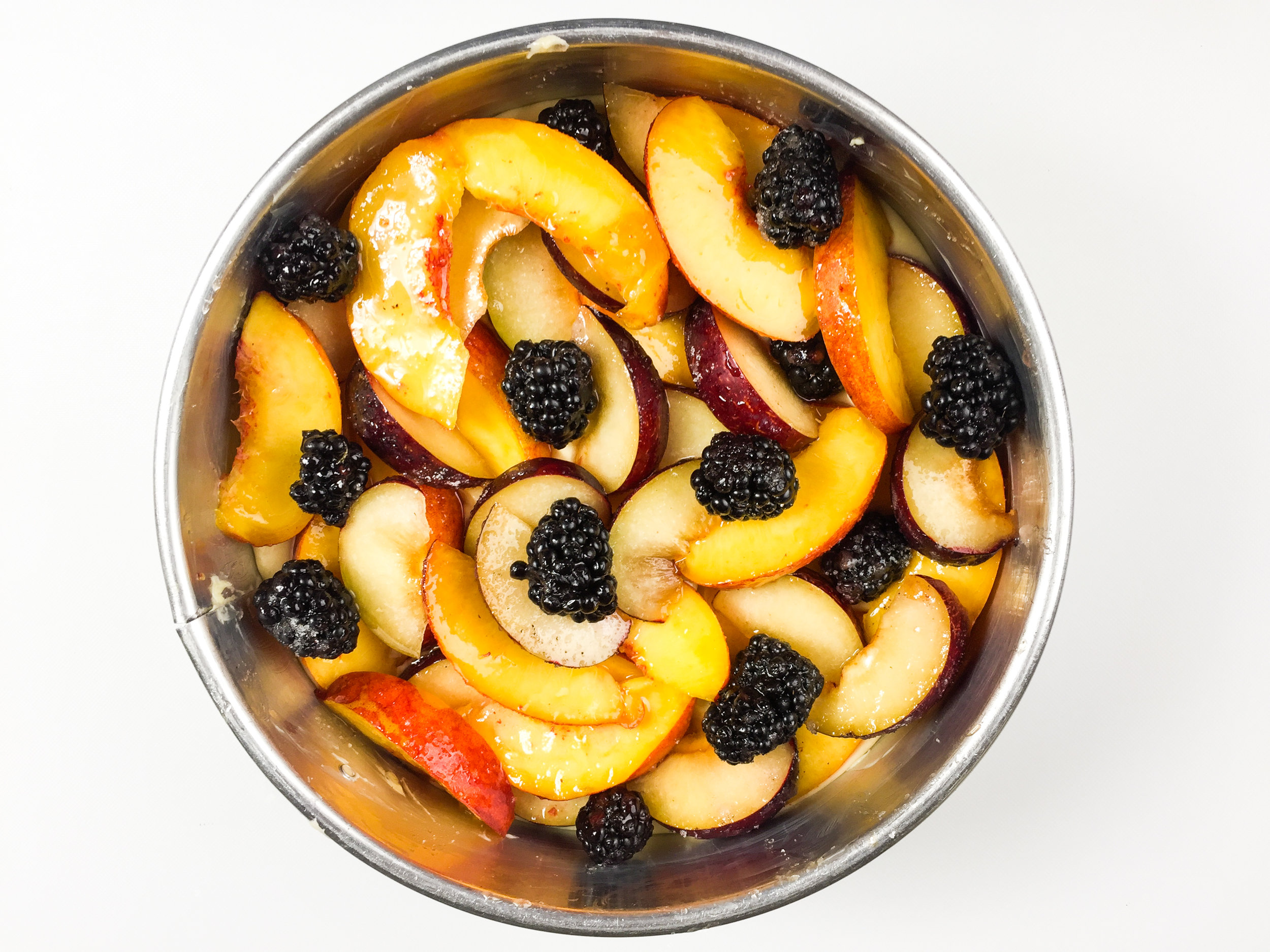 "Summer fruit arranged ""higgledy-piddledy"" on top of the batter"