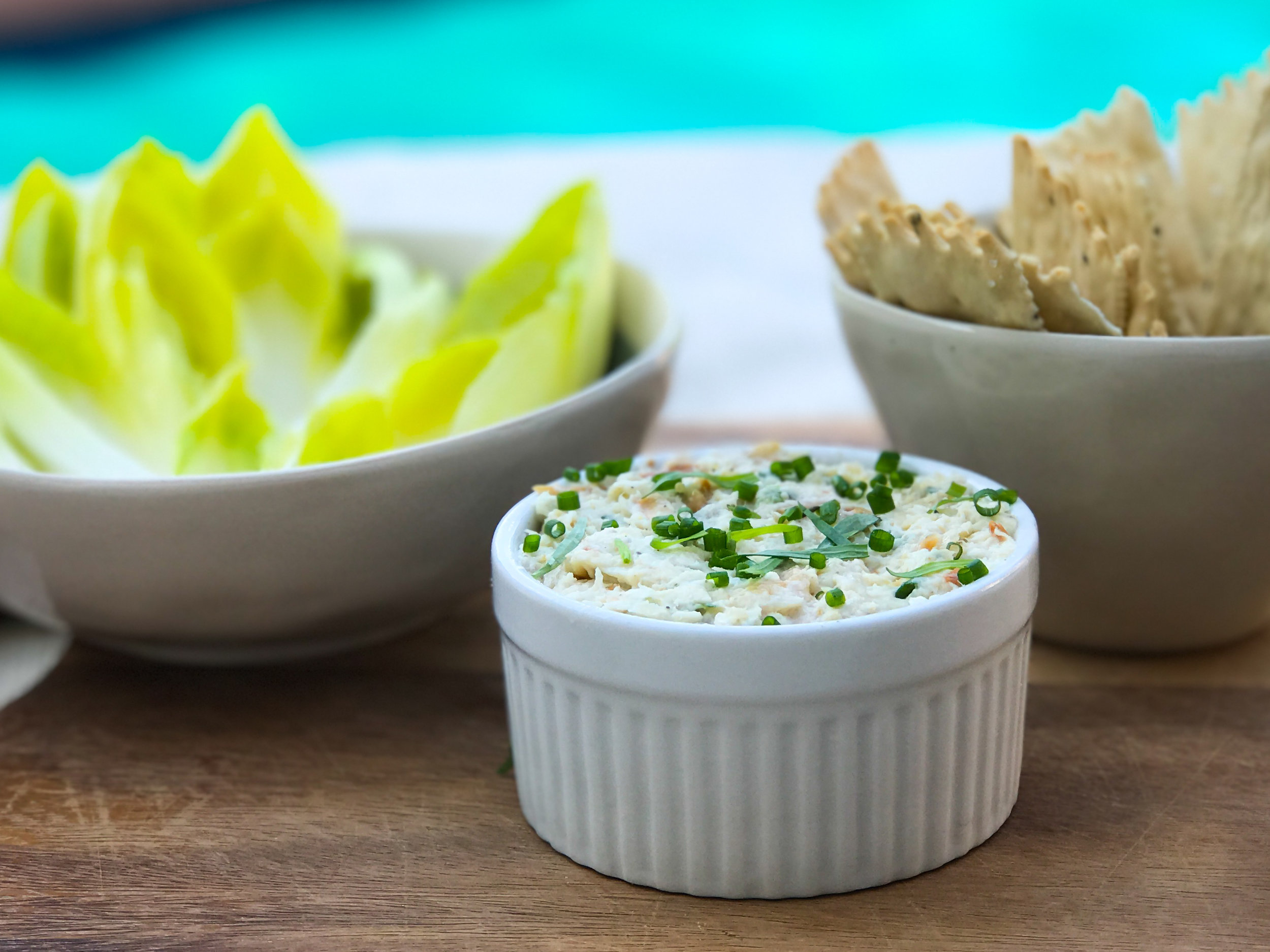 This year's Bastille Day feast starts with make-ahead smoked trout pâté, served with crackers and endive leaves.