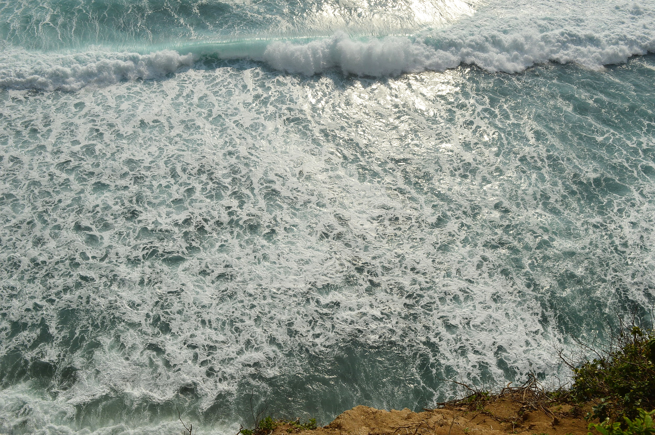Waves coming in at Uluwatu Temple in Bali - 14 things you must do on a trip to Bali