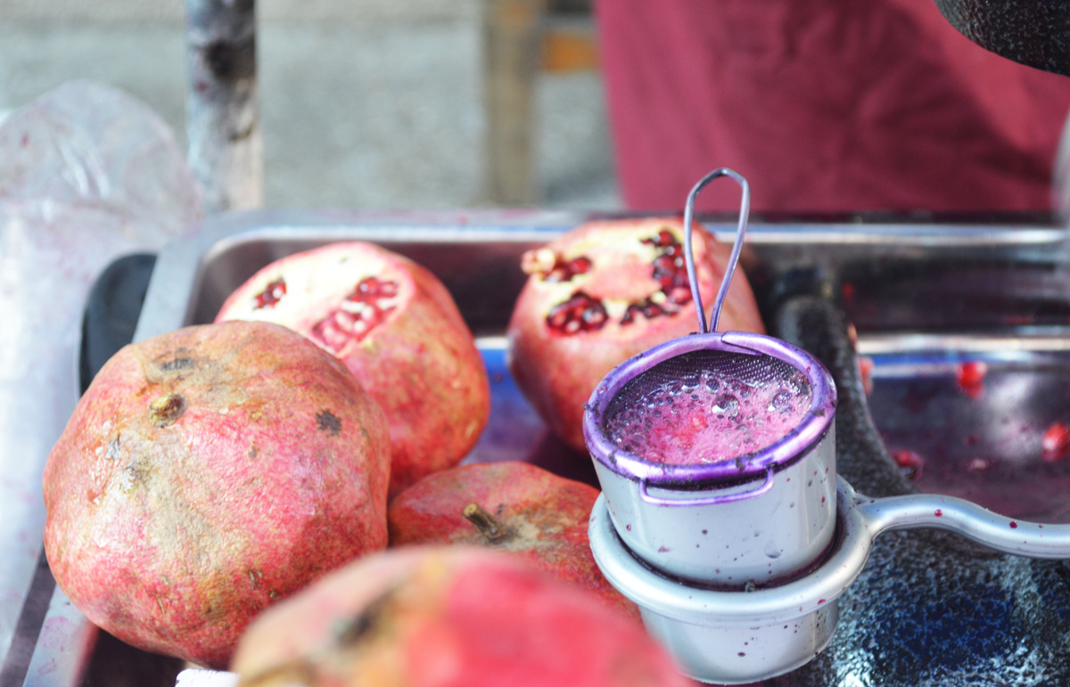 Freshly squeezed pomegranate juice on the side of the road