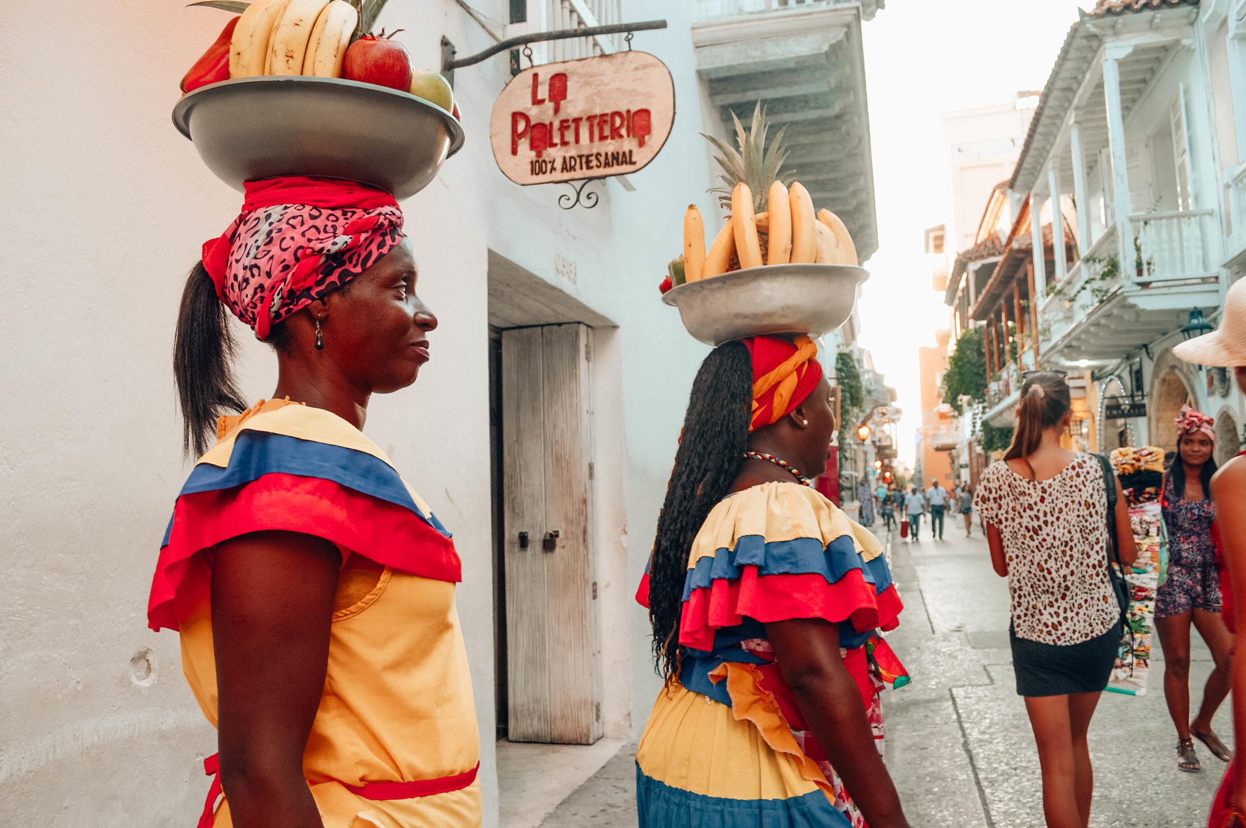 The traditionally dressed ladies with the fruit (you can pay them a tip to take a photo with them, which I did, haha) are walking around Cartagena