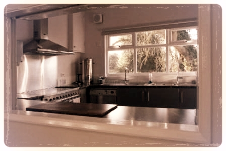 View of the kitchen through the serving hatch