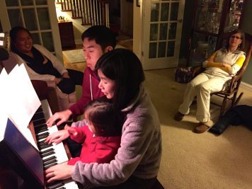 Playing piano with a little help from our niece :)
