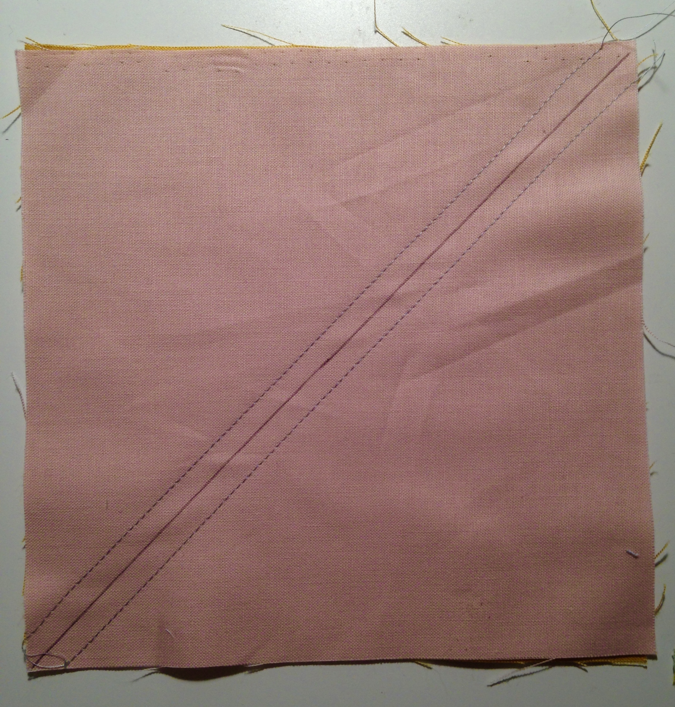 "2. Sew 1/4"" away from the drawn line on each side."