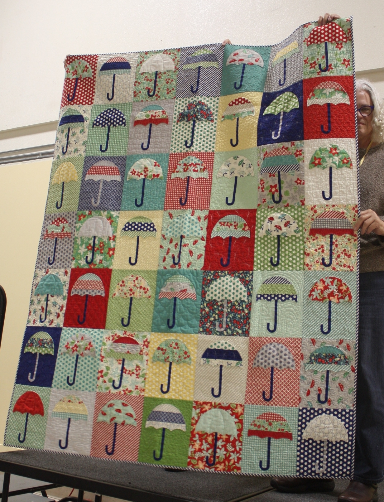 Karen Lee     Instagram: @quiltaposy    Rain Check Pattern by Thimble Blossoms    Quilted by Andrea Marquez