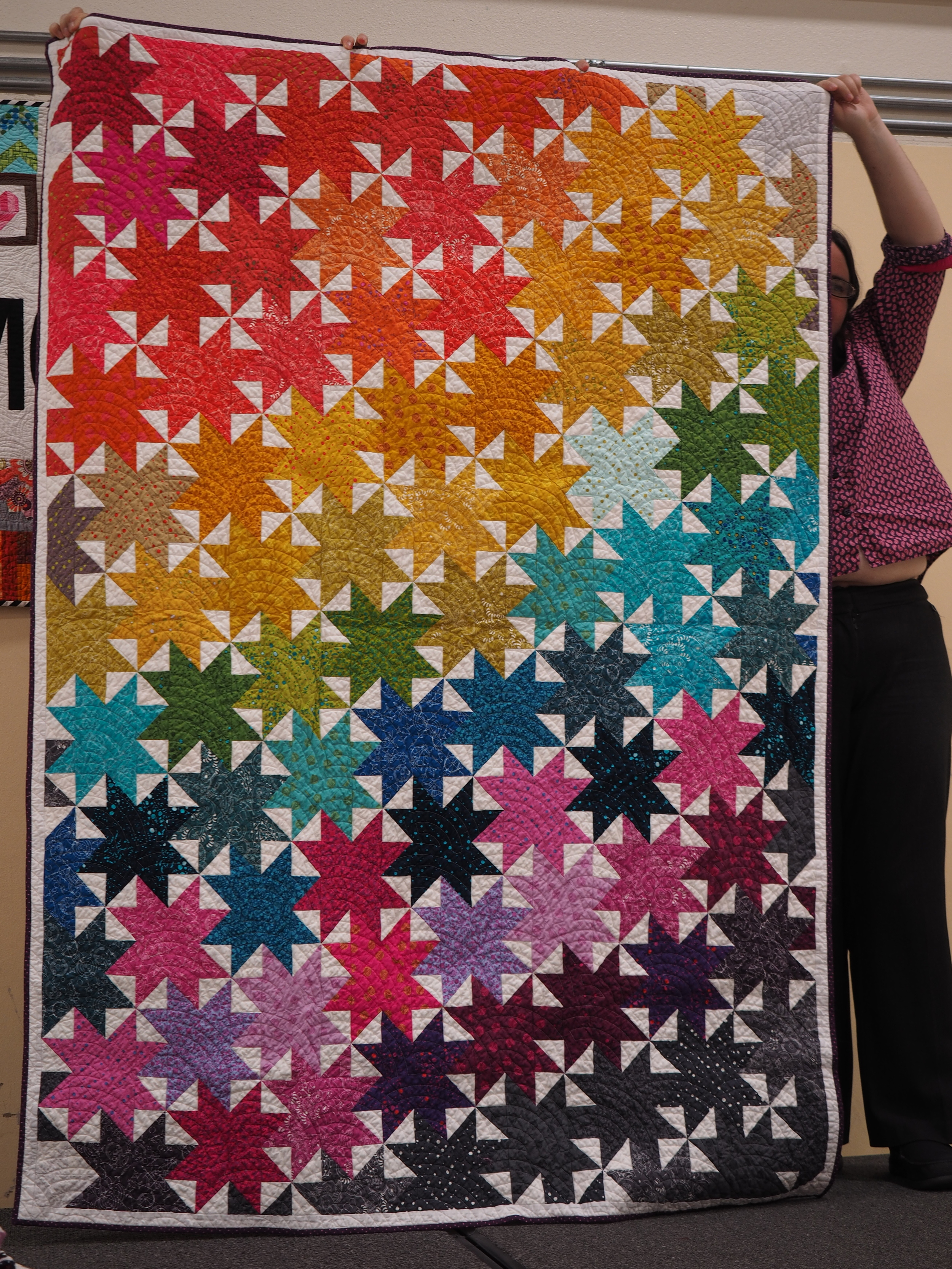 Ruthie Windsong  EpicSun Prints  @ruthiewindsong  My own design of nested stars, I made the first version of this in High School.  Quilted by Karlee Sandell @sewinspired2day