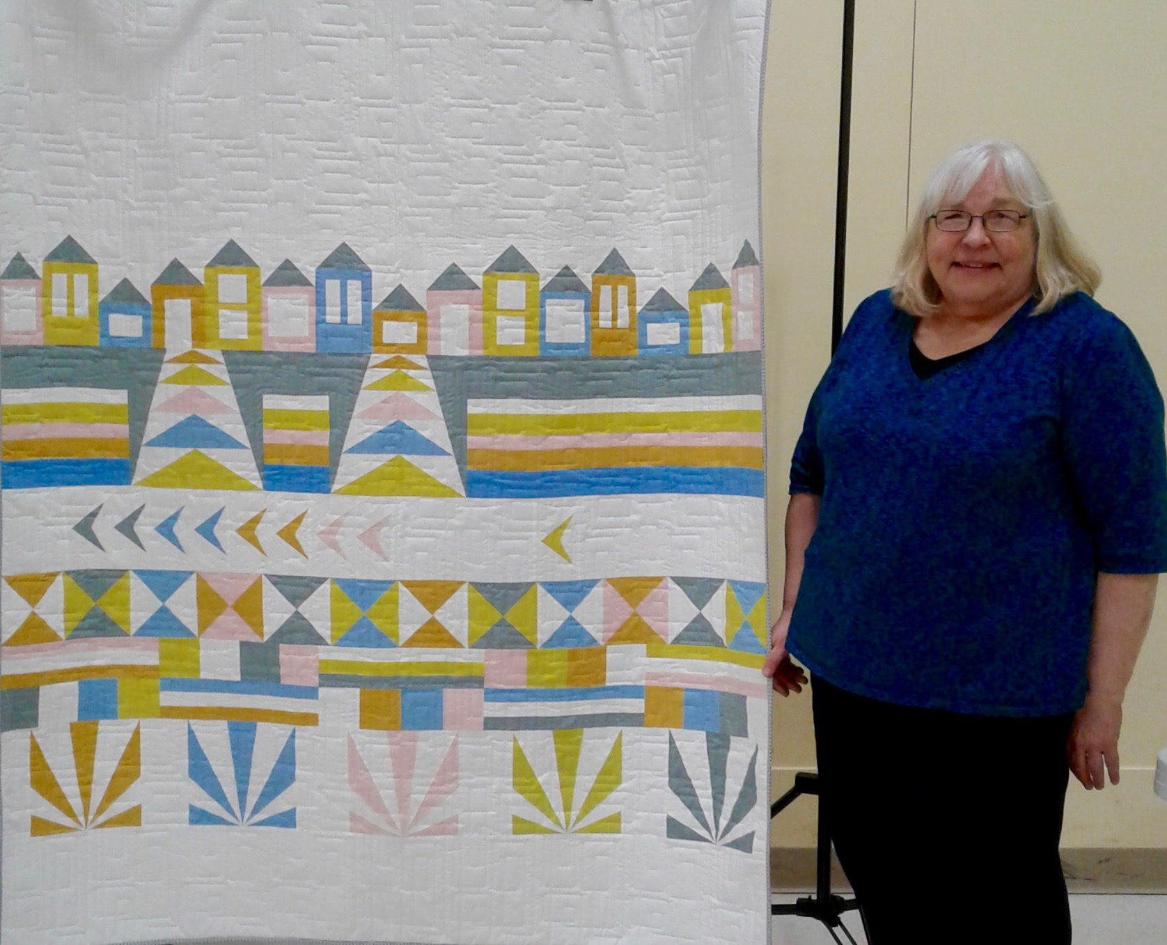Chris Carlson with her Row by Row quilt