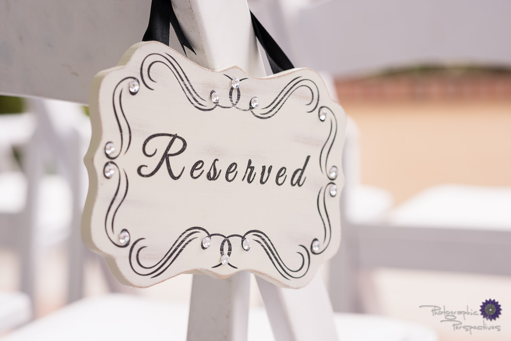 Wedding aisle reserved sign