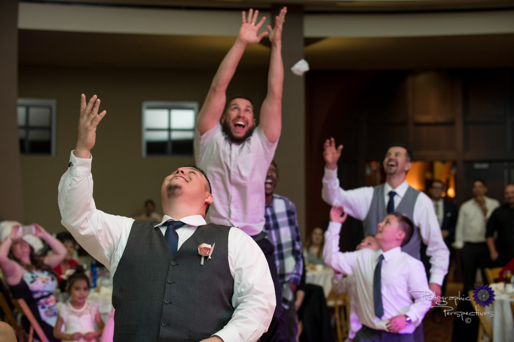 Albuquerque Wedding Photographers | Isleta Resort and Casino | Garter Toss.jpg