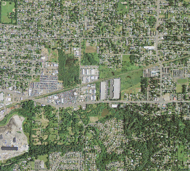A zoomed in view of the 'texture' raster and the original image. Notice how flat, grassy surfaces appear blue (low values), while the canopy appears tan brown (higher values).