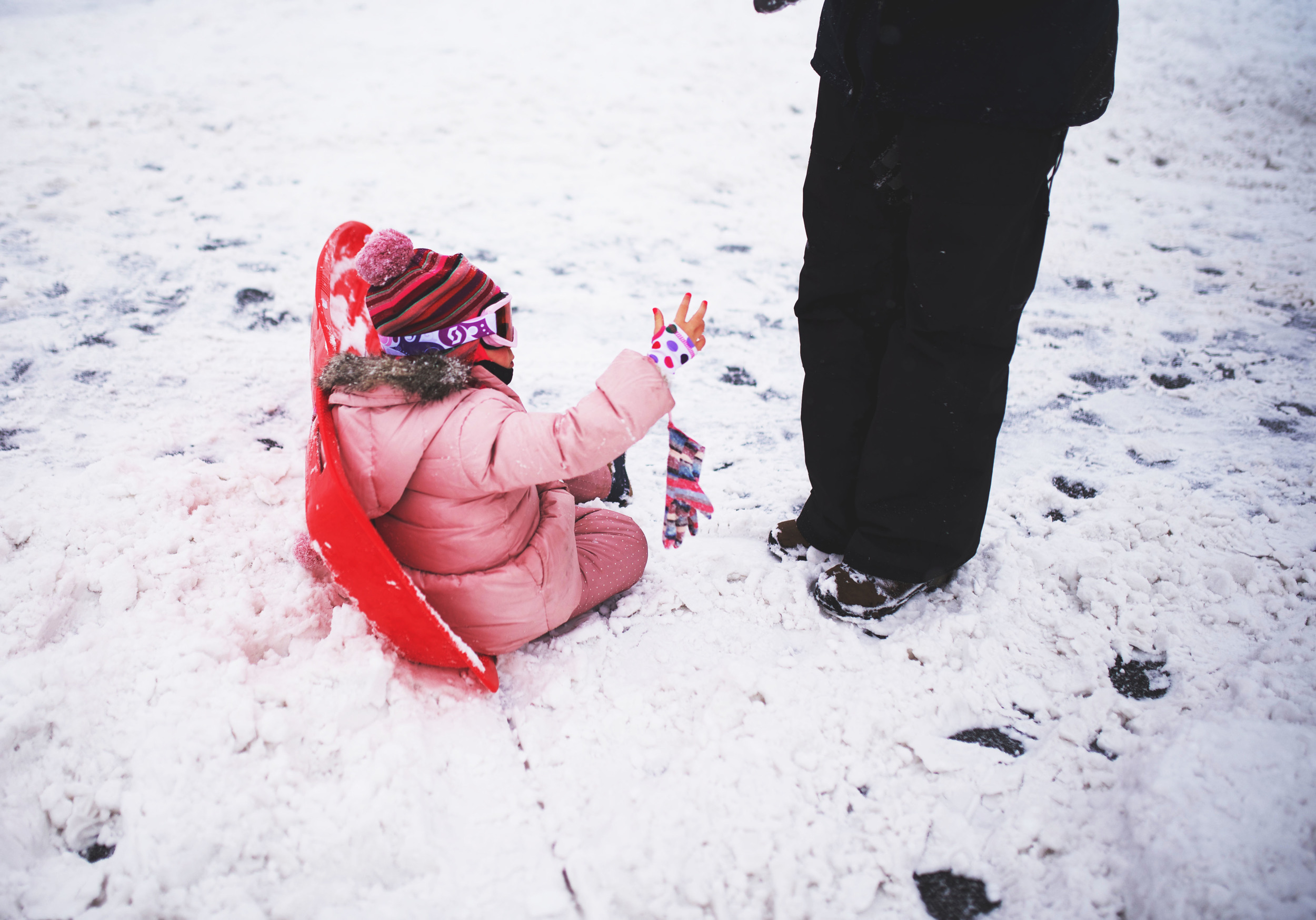 This little girl was adorable while her dad was helping her with her gloves