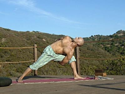 "Yogi Steven in ""Bound Warrior"" pose"