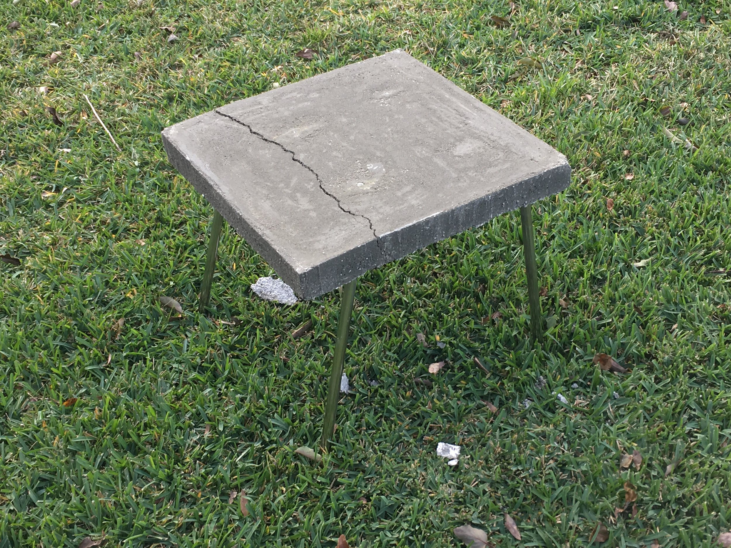 "While laying the concrete, the chair frame held a depth too close to the surface of the concrete. The form was casted with a ""crack"" and inevitably broke. Luckily the switch to a foam base reduced the weight a considerable amount and made it a more appropriate piece of furniture."