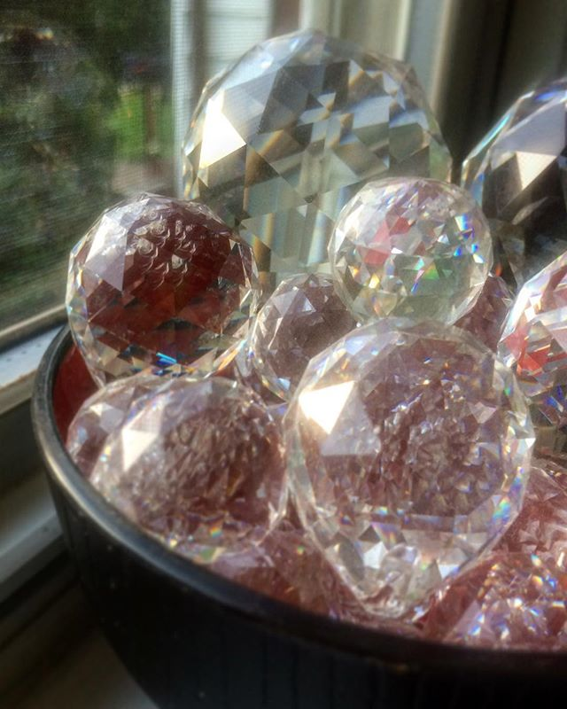 "This particular Feng Shui cure originated from Professor Lin Yun's BTB School. It was created as a means to offer simple, yet profound ways in how to shift the vibrational energy of a home. The main ingredient includes a multi-faceted Swarovski sphere crystal that is between 20 mm, 30mm to 40mm in size and red string or ribbon cut at 9 inches.  This particular type of crystal stops beneficial Qi from sweeping away (i.e. door aligned with a window). Imagine the rushing energy moving like water and when it meets the crystal, the energy spreads throughout the room and home more evenly vs sweeping 'in and out.' Typically, the crystal is hung from the ceiling by a 9 inch red string, positioned mid-way between the door and window.  In Tibetan Tantric Buddhism, they practice the ""Rainbow Body Meditation,"" which adopts the rainbow color spectrum into the mind and body to help improve physical health, spirituality, better judgment, and increase personal virtues - patience, compassion, etc. Essentially, this is what the Swarovski crystal is doing. As the natural sunlight filters through the crystal sphere, it captures rainbow light and beams it into your home. This can be felt even more, if you choose to hang the crystal near the window. But be aware of the sun's strength. It's recommended to position the crystal in such a way where it's not in direct alignment with the sun rays for safety reasons.  #SwarovskiCrystals,#crystals,#BTBFengShui,#fengshuitips,#fengshuibylauracerrano,#fengshuimanhattan,#fengshuitip,#studioapartment #nycrealestate,#nycliving,#apartmentliving,#fengshuiexpert, #femaleentrepreneur,#holistichomes,#environmentalpsychology,#corcorangroup,#apartmenttherapy,#reikimaster,#reiki,#LAliving,#Home,#Condo,#minimalism,#fengshuilifestyle,#holisticlifestyle,#mondaymotivation,#LIC,#longislandcity"