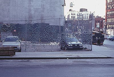 Royal Pine , 1998, Little Tree air fresheners, zip ties, mounted on existing cyclone fence, east village, New York City  With permission from The Cooper Union School of Art and Architecture, and material donatation from  The Little Tree Corporation.