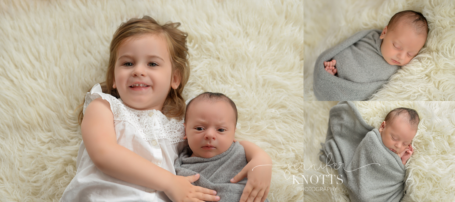 toddler sister wraps arms around newborn brother and both look into the camera