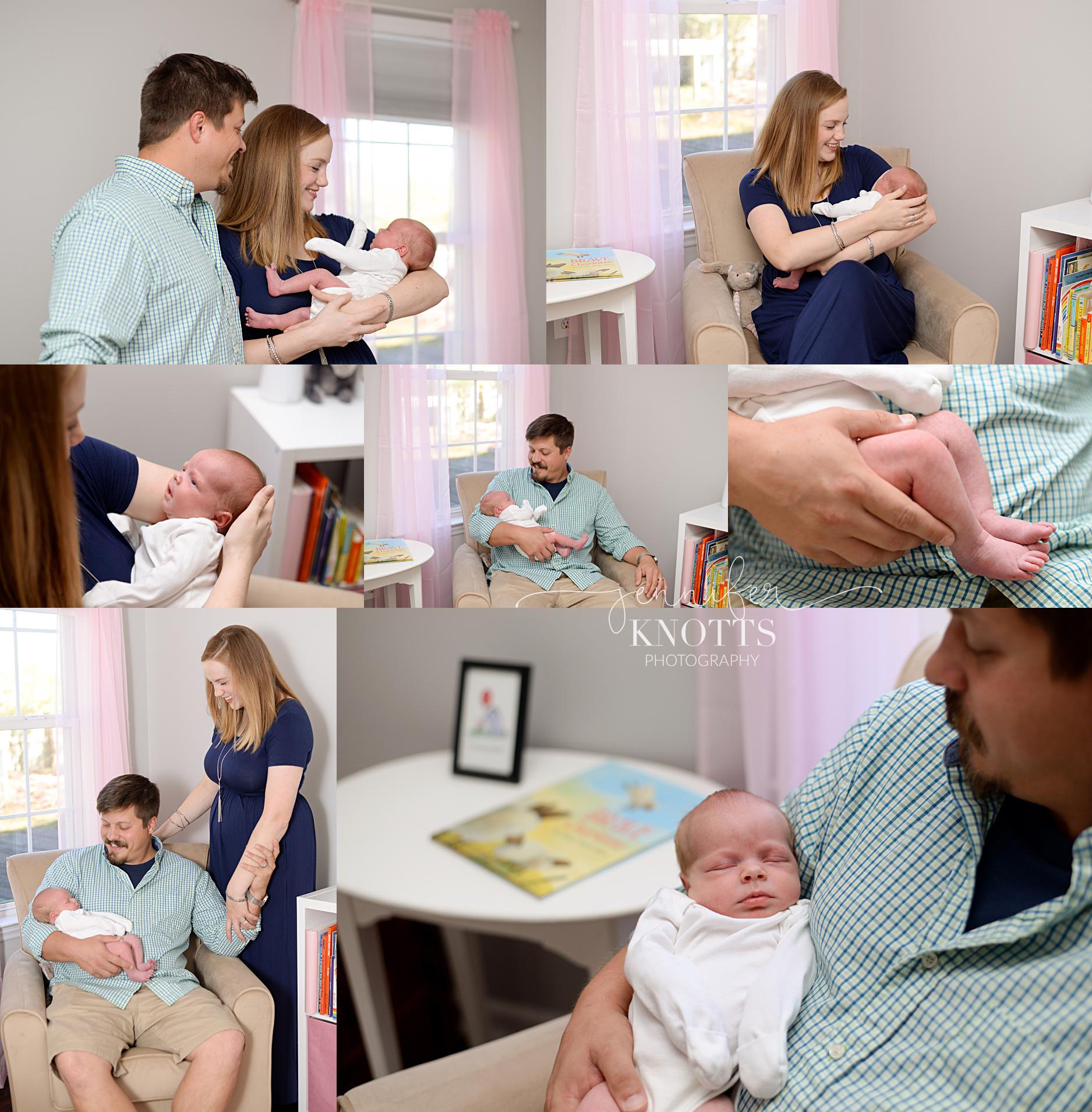 parents hold newborn daughter in Wilmington nc nursery