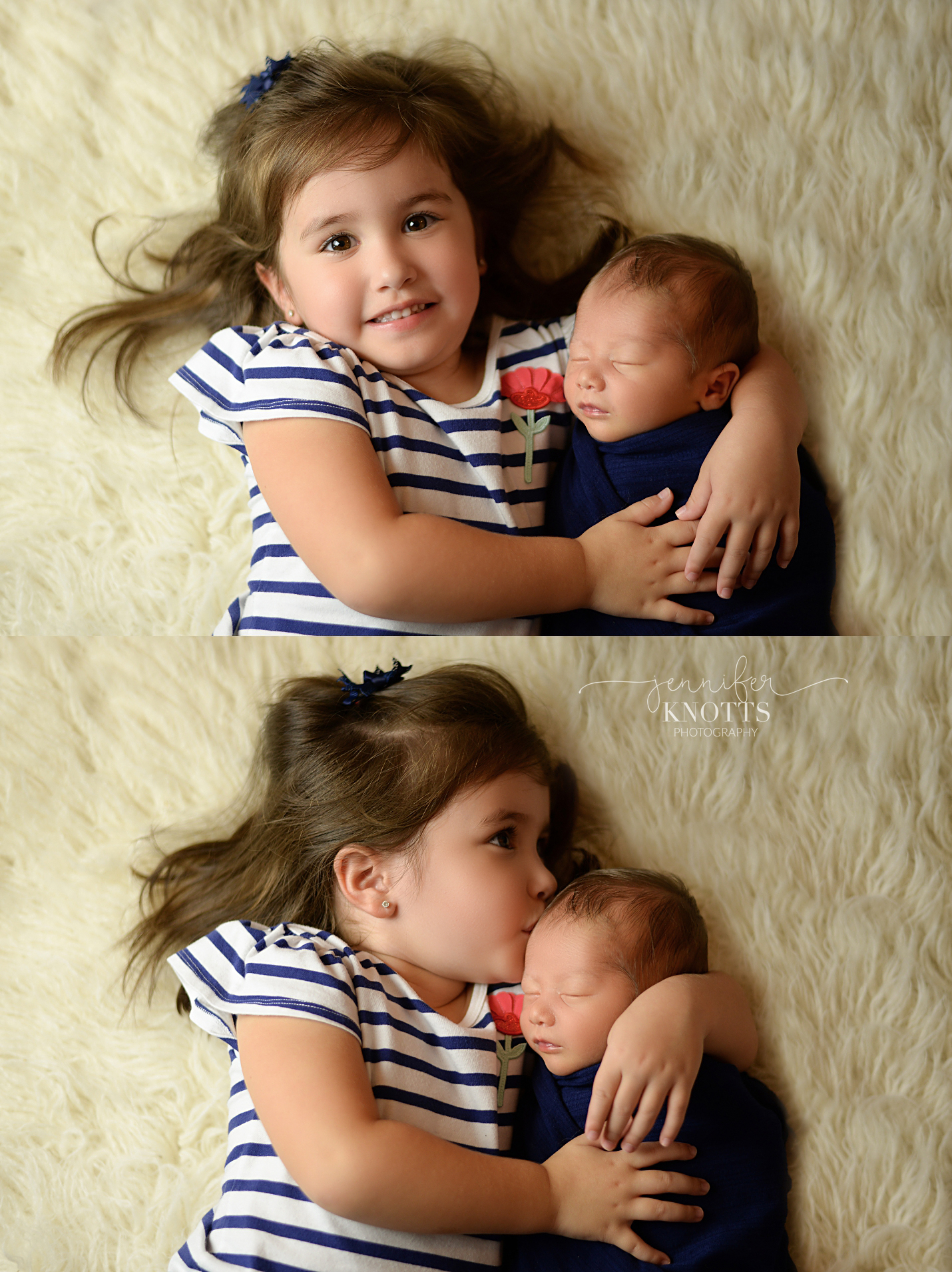 big sister hugs swaddled baby brother while resting on cream fur background