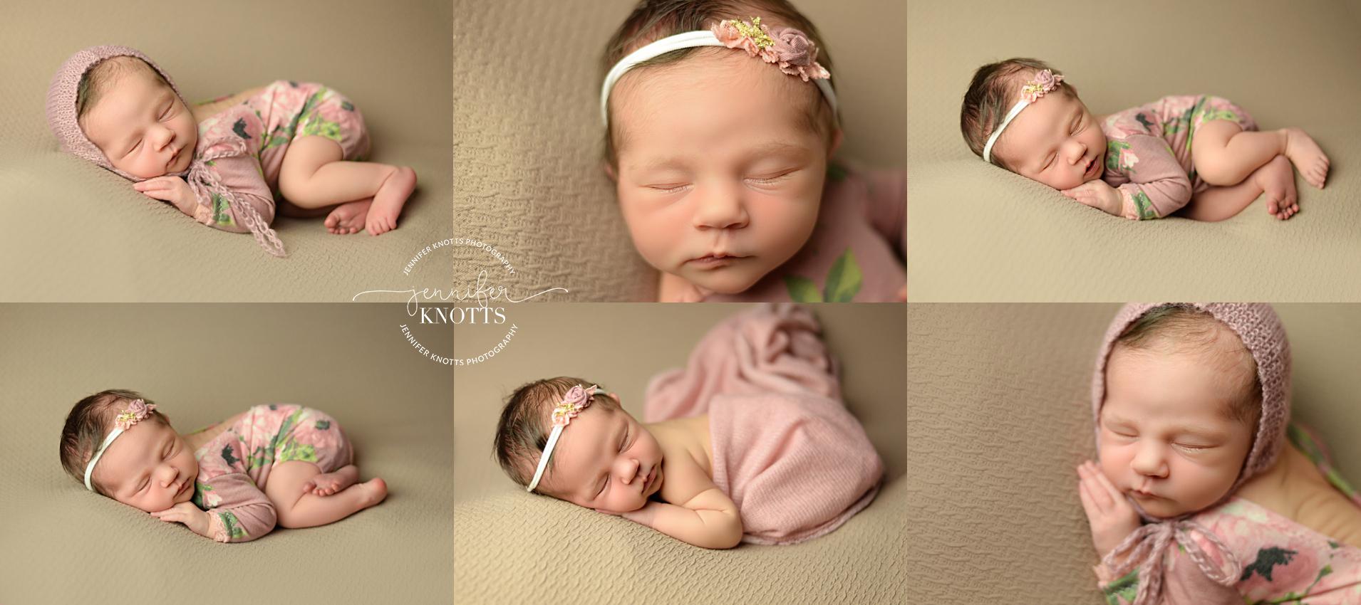 Baby girl sleeps on tan fabric wearing floral romper