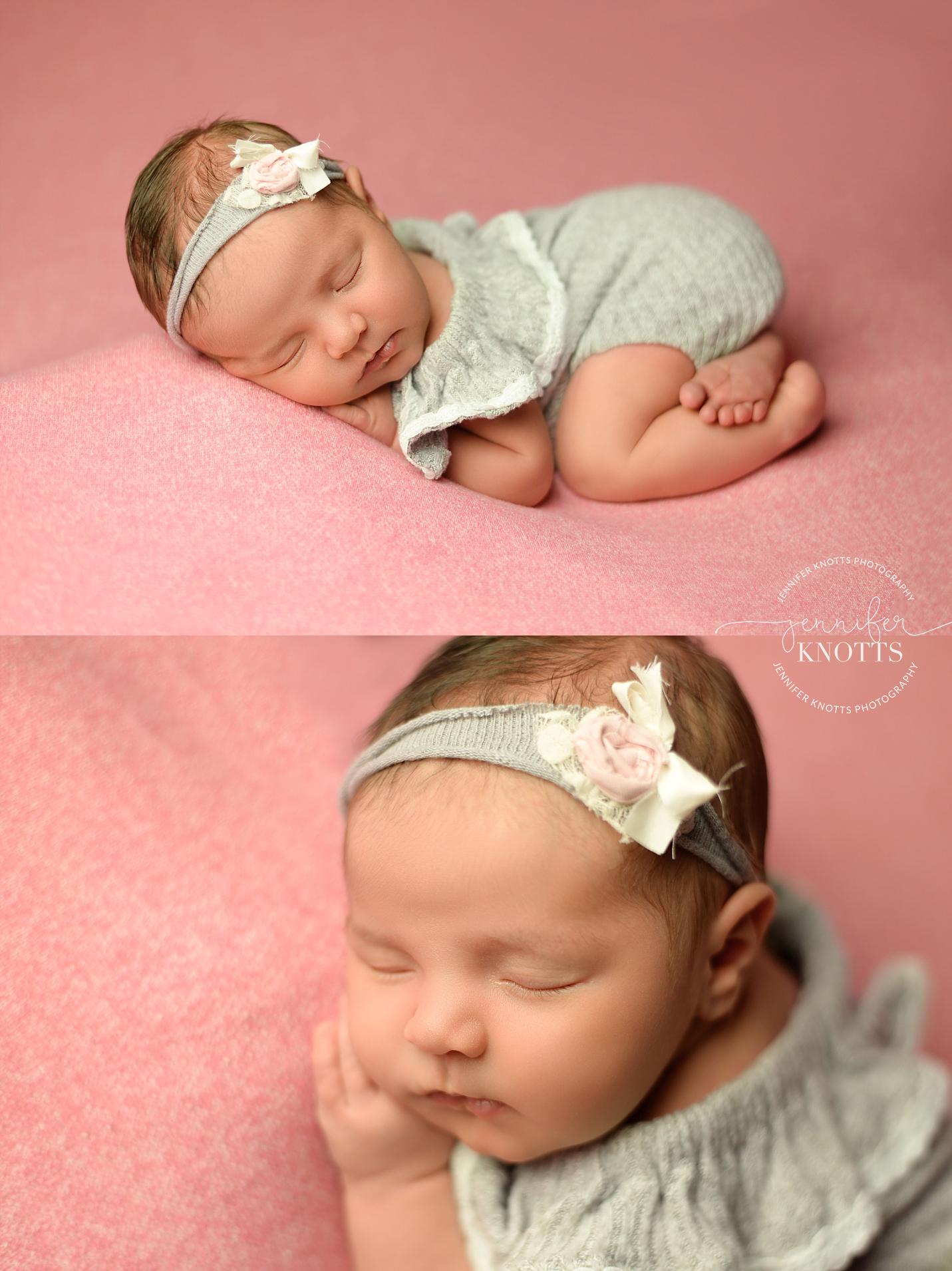 wilmington newborn photographer captures baby girl sleeping on pink fabric with hands tucked under cheeks