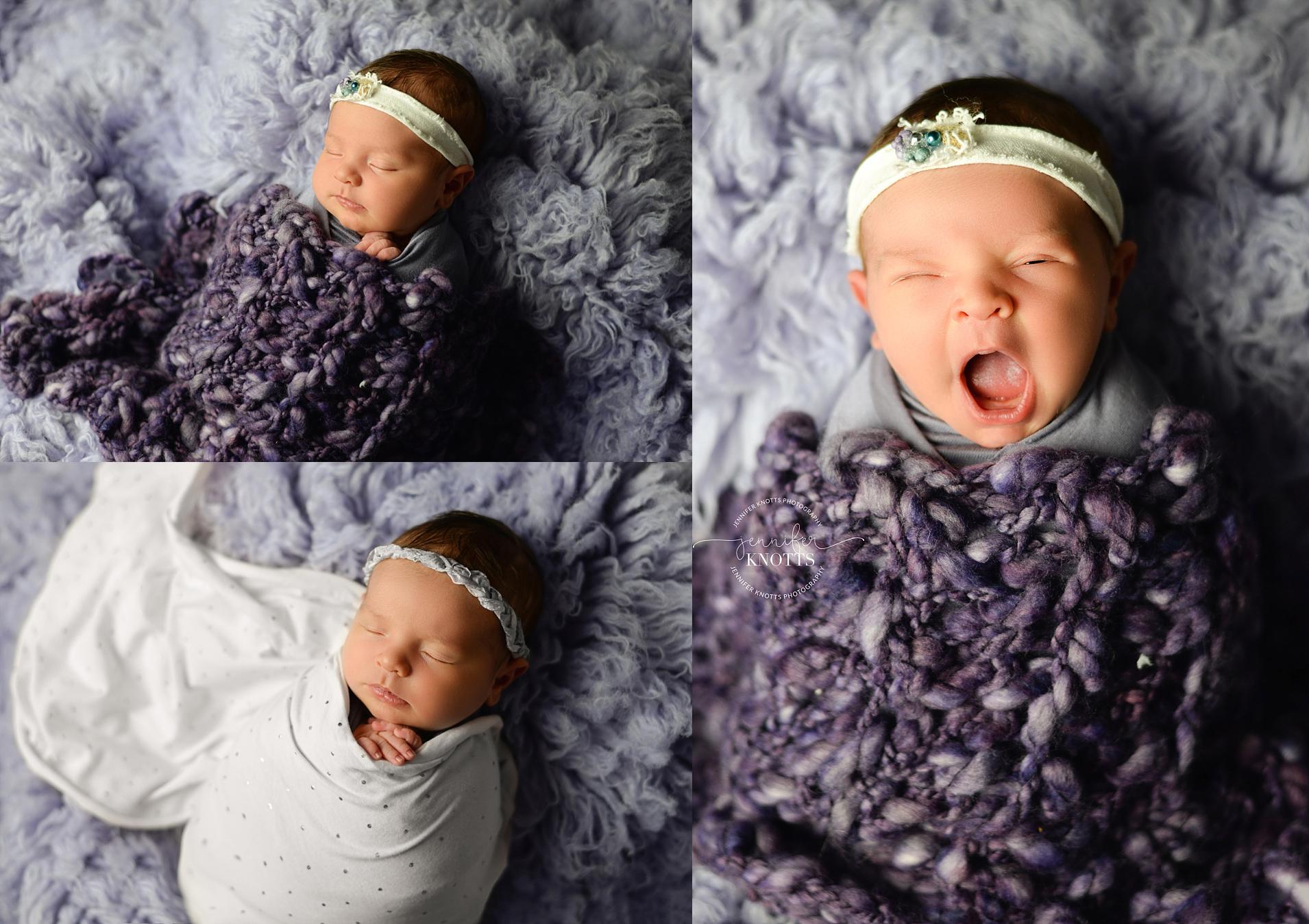 baby girl sleeps and yawns on purple fabric