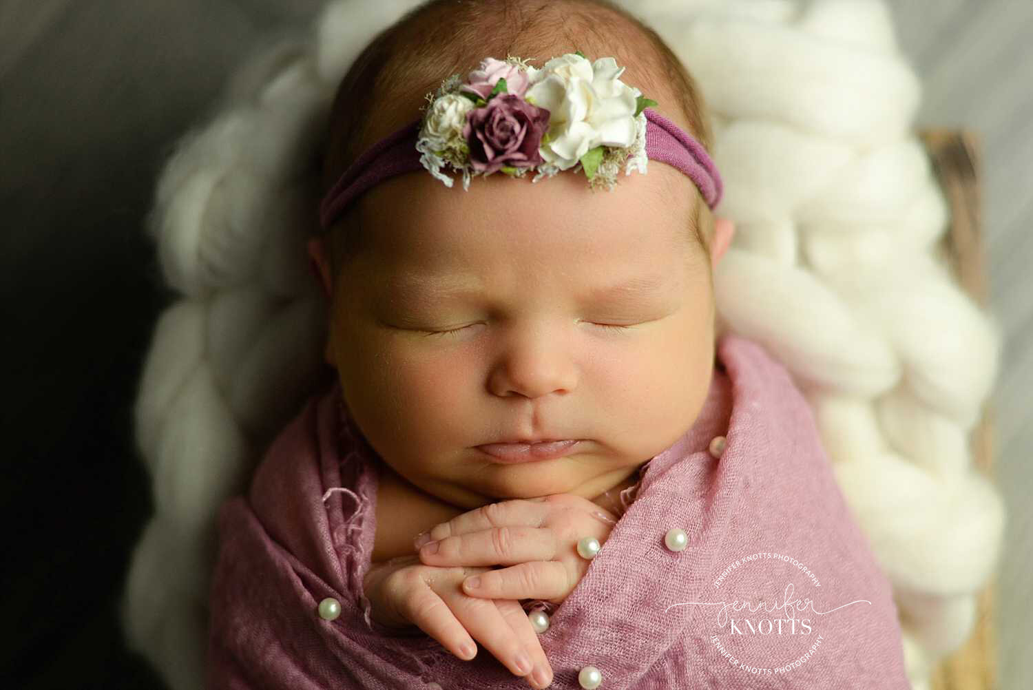 wilmington newborn photographer captures baby girl wrapped in pink