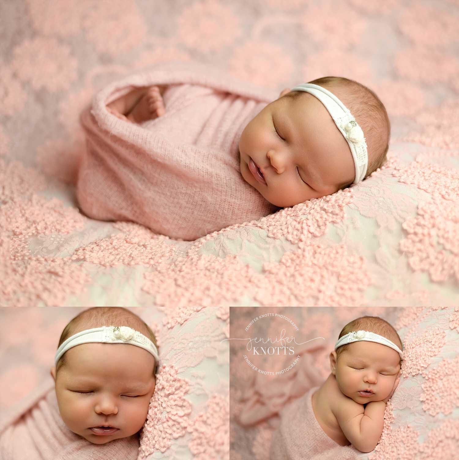 newborn sleeps on pink textured backdrop wearing white headband