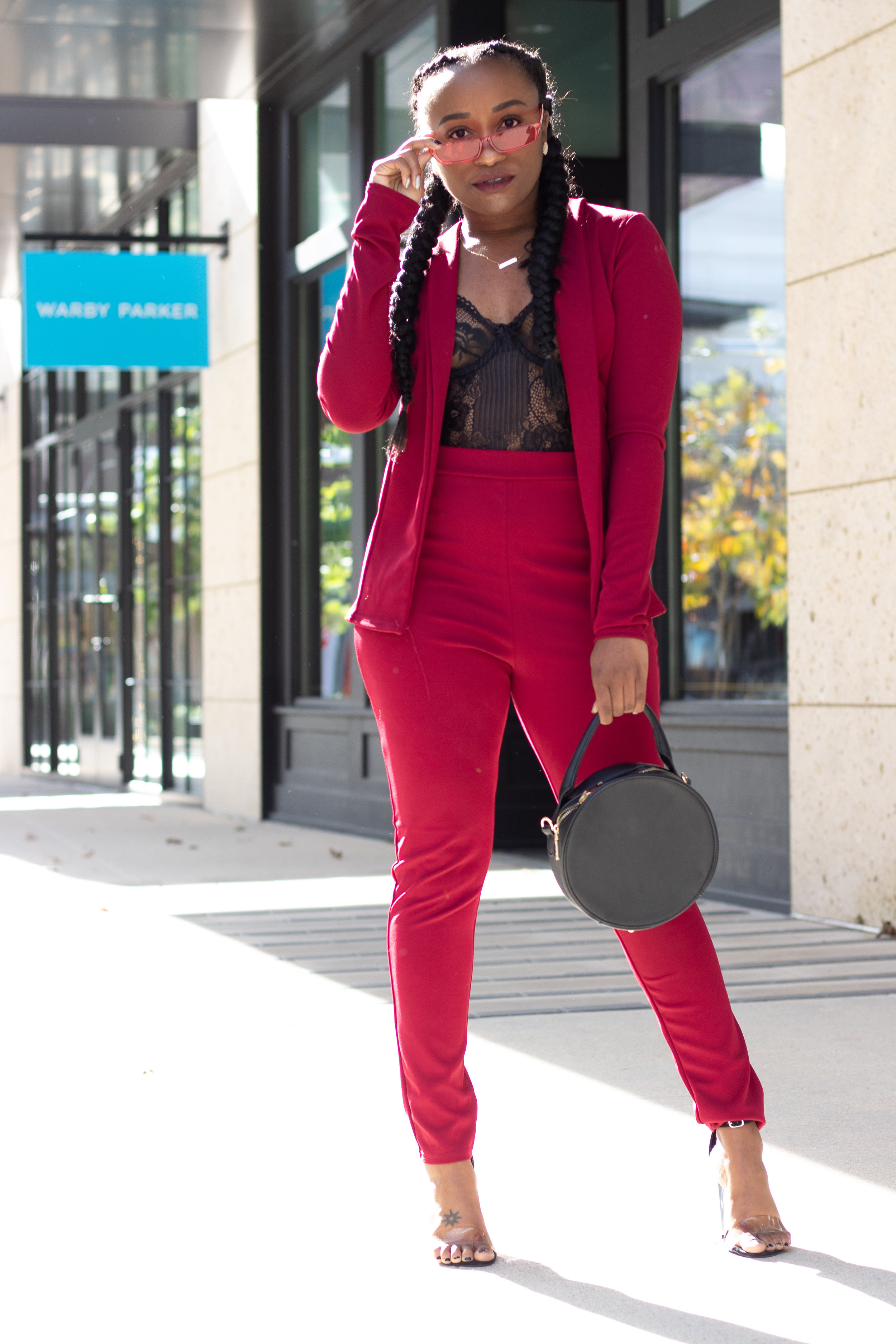 THE DEETS:  Crepe Fitted Suit -  Boohoo ; Lace & Mesh Bodysuit -   Boohoo  ; Black Perspex Heels -   EGO Official   ;  Red Cat Eye Sunglasses -     Attention Frames * ; Circle Purse -   AKIRA*     *similar style