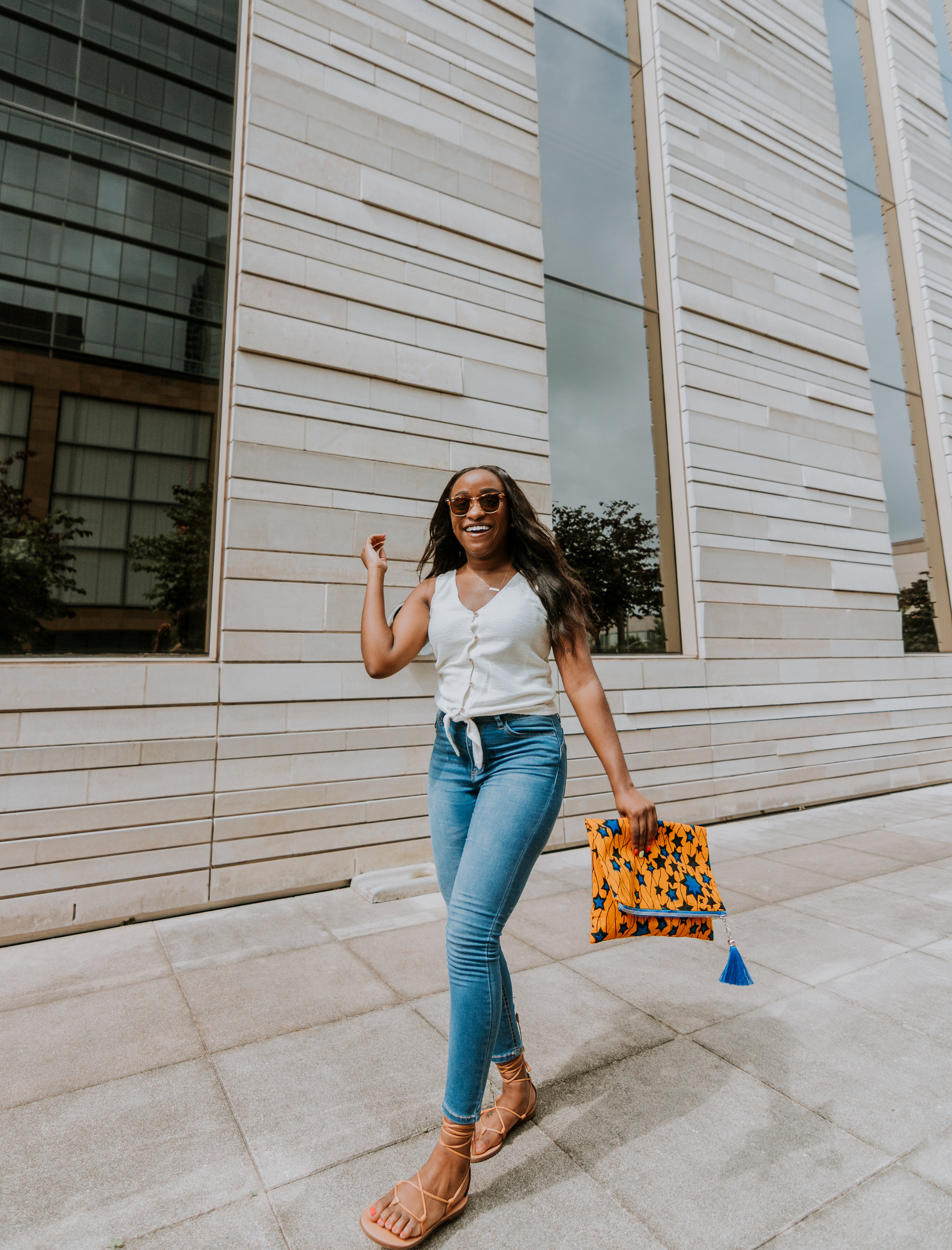 THE DEETS:  Texture & Thread Button-Front Tie Top -   Madewell  ; High-rise Skinny Crop Jeans -   Fashion Nova  ; Boardwalk Lace-up Sandals -   Madewell  ; OMA Ankara Clutch Purse -  AboveandBeyondDzyns  ; Clubmaster Sunglasses -   Ray-Ban