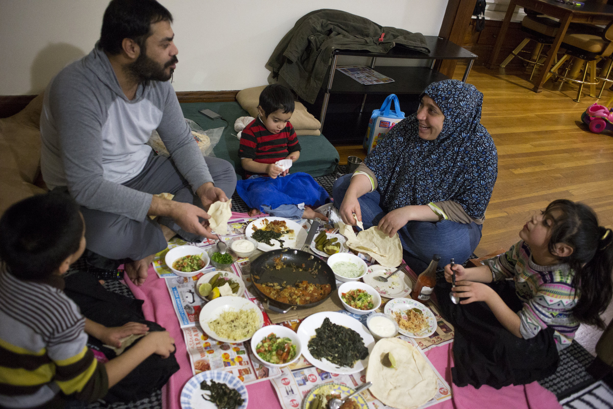 The family enjoys a homecooked meal after the end of a long day.