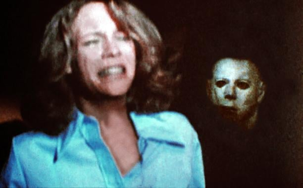 Jamie Lee Curtis suitably cowering from Michael Myers.