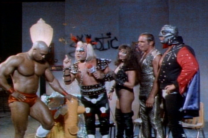 PLENTY OF HIGH KITSCH FACTOR FROM THE CAST. FROM LEFT TO RIGHT: CAPTAIN CARNAGE (BILL GRANT), EXOTIC ADRIAN STREET, STREET'S VALET (AND REAL LIFE WIFE) MISS LINDA, GOLDEN GREEK JOHN TOLOS AND THE MASK