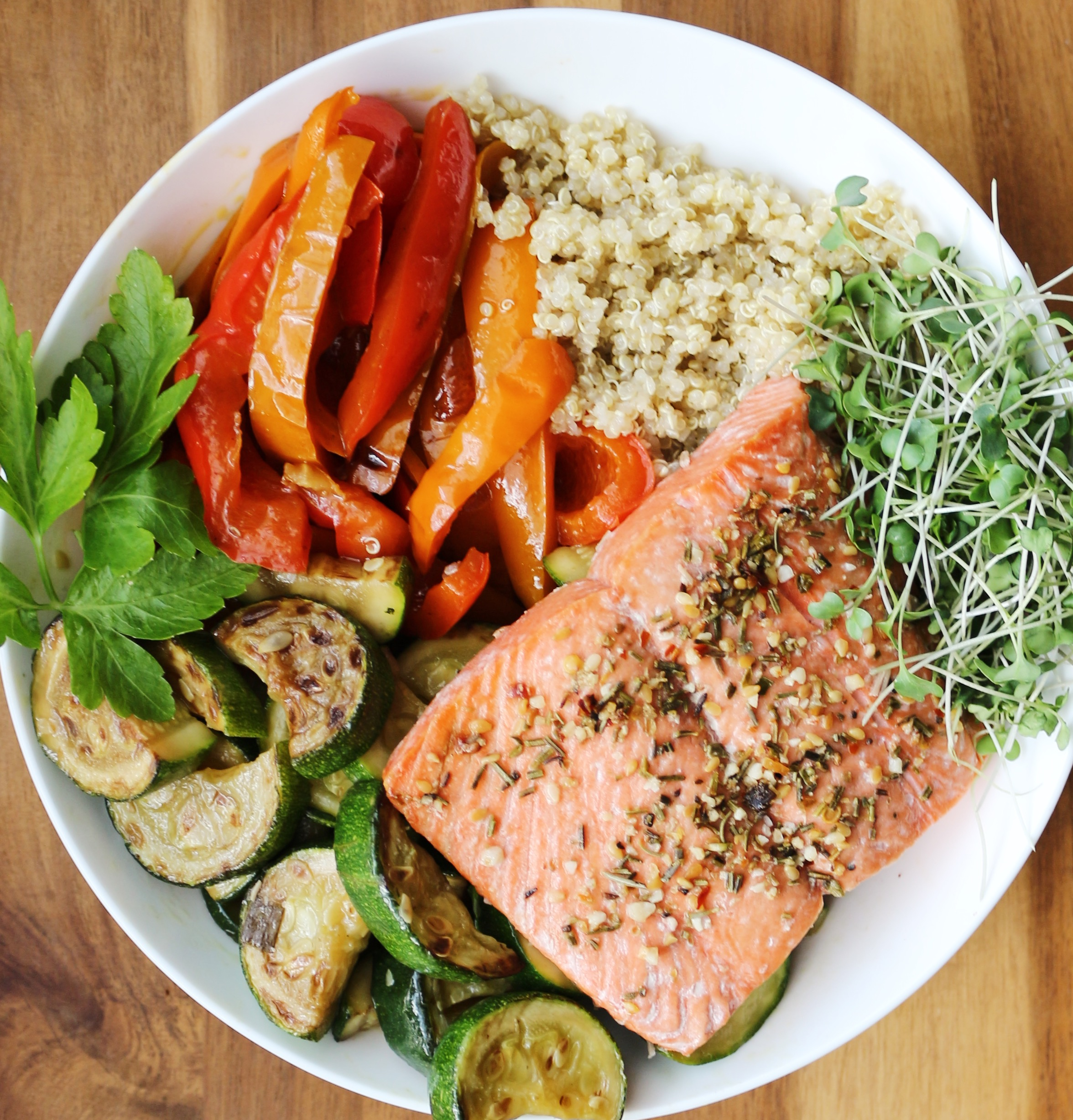 4 oz. of baked salmon with roasted zucchini and bell peppers, quinoa, andmicro greens