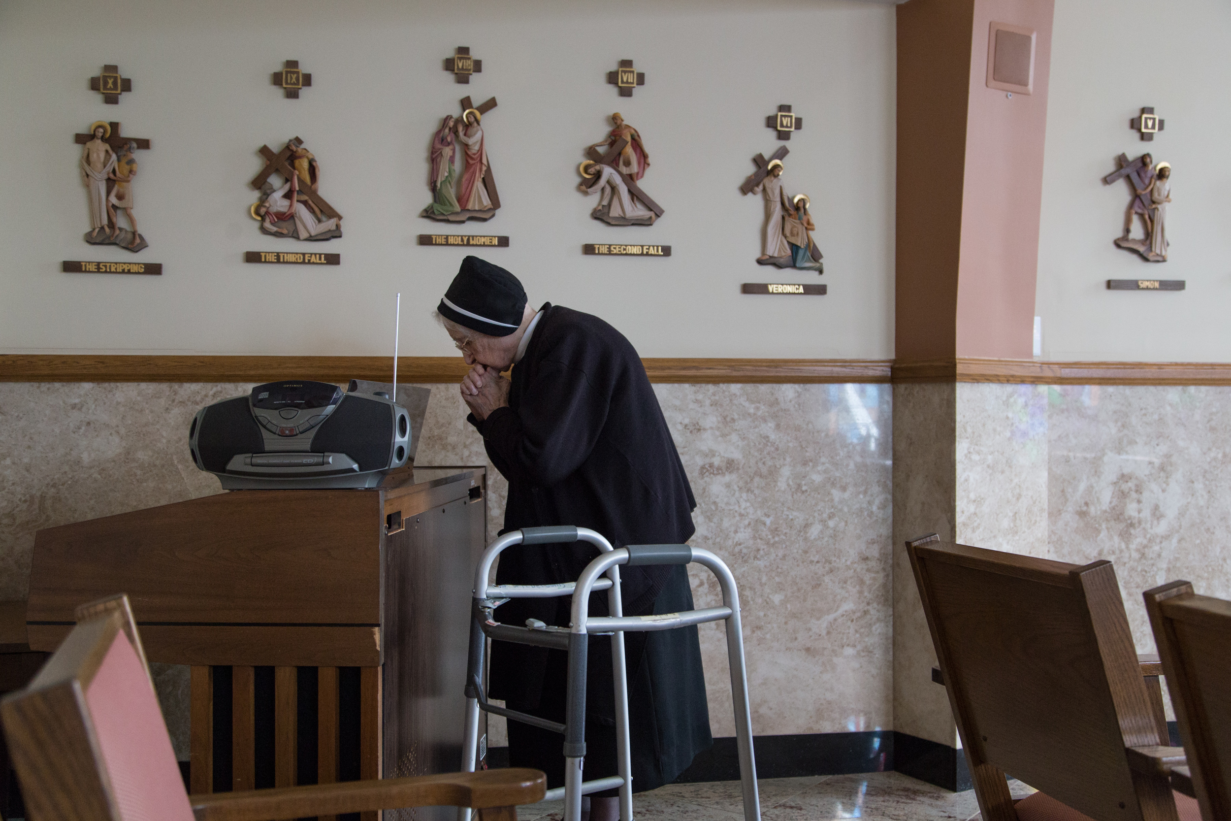 One of the oldest living Filippini Sisters, at 103, prays in the chapel.