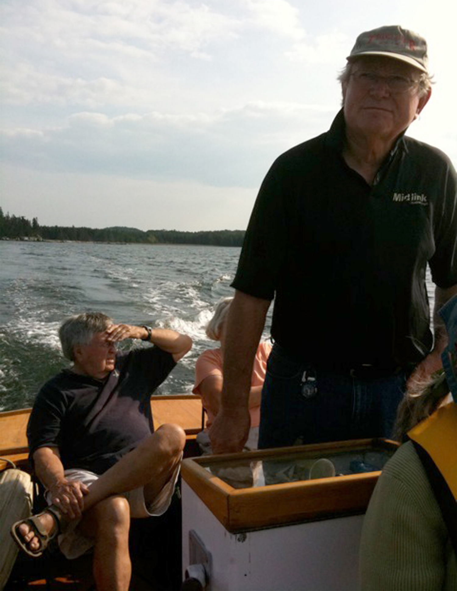 Dave Smith at the helm with Deane Richardson on the water in Castine, Maine