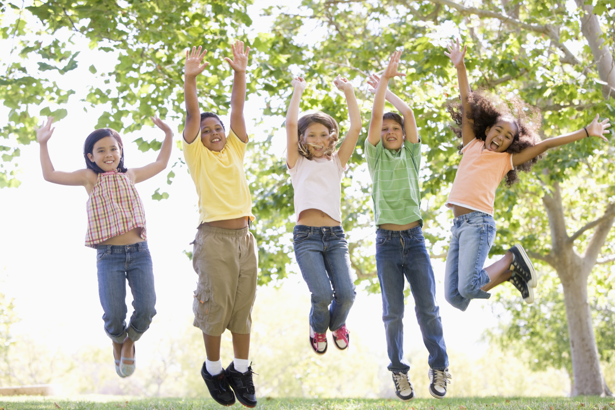 Photo of happy children jumping during an outdoors summer event. Photo by monkeybusinessimages/iStock / Getty Images