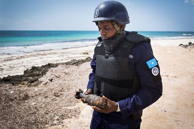 A member of the Somali Police Force bomb disposal unit carries a live mortar to the detonation site in Mogadishu, Somalia. While the Somali government has made significant progress in reducing the territory held by al-shabaab insurgents, the group still holds control over large areas of South Central Somalia. Members of the Somali Police Force are often the first line of defense against the deadly terror attacks they Carey out in Mogadishu, and their bomb disposal unit works tirelessly to protect civilians from errant mortars or IEDs. This image from a 2015 assignment with @un_mineaction. . . . #somalia #security #un #documist #ied #bomb #journalism #potd #reportage #fs7 #sony #canon6d #35mm #mogadishu #mortar #bts #behindthevid #behindthescenes #burnmagazine #photooftheday #color
