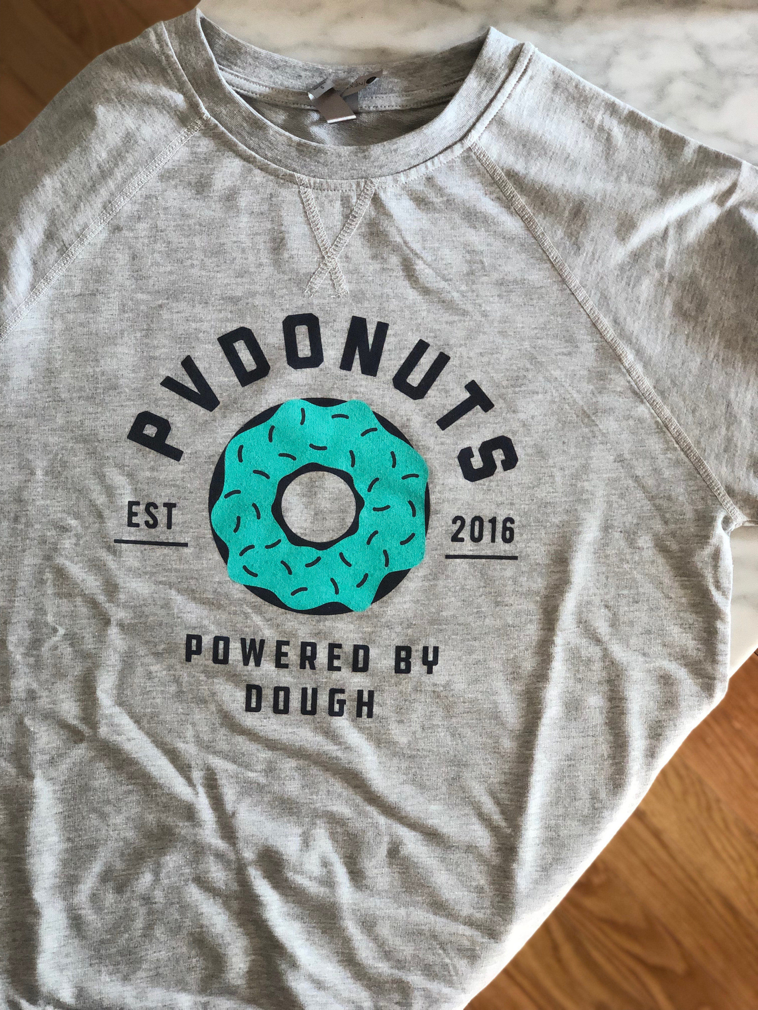 Powered By Dough Crew Neck - $27    Available Size(s) - Small - XL (unisex)
