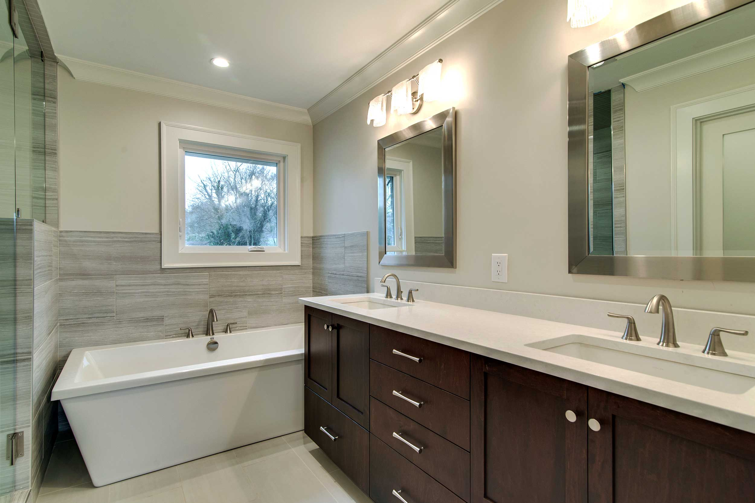 pebble_gray_tile_walnut_cabinet_soaking_tub_bathroom.jpg